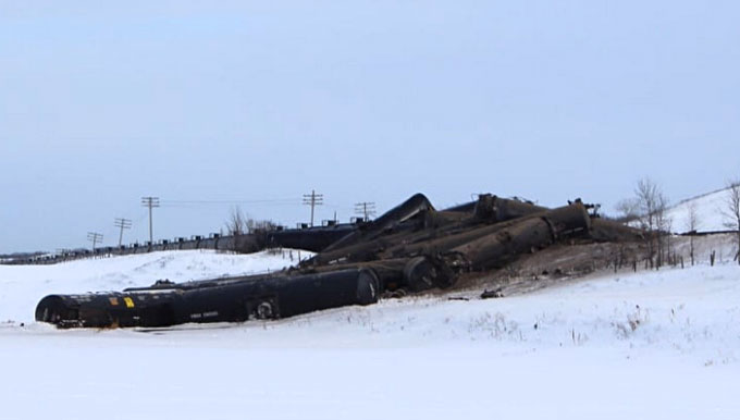 Crude in the air': Oil carrying train derails near western Manitoba village